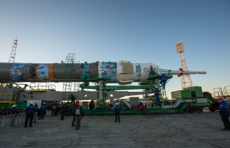 The Soyuz TMA-11M rocket, adorned with the logo of the Sochi Olympic Organizing Committee and other related artwork, arrives at the launch pad by train on Tuesday, Nov. 5, 2013, at the Baikonur Cosmodrome in Kazakhstan. Launch of the Soyuz rocket is scheduled for November 7 and will send Expedition 38 Soyuz Commander Mikhail Tyurin of Roscosmos, Flight Engineer Rick Mastracchio of NASA and Flight Engineer Koichi Wakata of the Japan Aerospace Exploration Agency on a six-month mission aboard the International Space Station. Photo Credit: (NASA/Bill Ingalls)