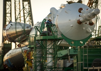 An engineer works on the Soyuz TMA-11M rocket shortly after it arrived at the launch pad by train on Tuesday, Nov. 5, 2013, at the Baikonur Cosmodrome in Kazakhstan. Launch of the Soyuz rocket is scheduled for November 7 and will send Expedition 38 Soyuz Commander Mikhail Tyurin of Roscosmos, Flight Engineer Rick Mastracchio of NASA and Flight Engineer Koichi Wakata of the Japan Aerospace Exploration Agency on a six-month mission aboard the International Space Station. Photo Credit: (NASA/Bill Ingalls)