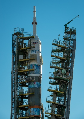 The Soyuz TMA-11M rocket, adorned with the logo of the Sochi Olympic Organizing Committee and other related artwork, as the service structure arms are raised into position at the launch pad on Tuesday, Nov. 5, 2013, at the Baikonur Cosmodrome in Kazakhstan. Launch of the Soyuz rocket is scheduled for November 7 and will send Expedition 38 Soyuz Commander Mikhail Tyurin of Roscosmos, Flight Engineer Rick Mastracchio of NASA and Flight Engineer Koichi Wakata of the Japan Aerospace Exploration Agency on a six-month mission aboard the International Space Station. Photo Credit: (NASA/Bill Ingalls)