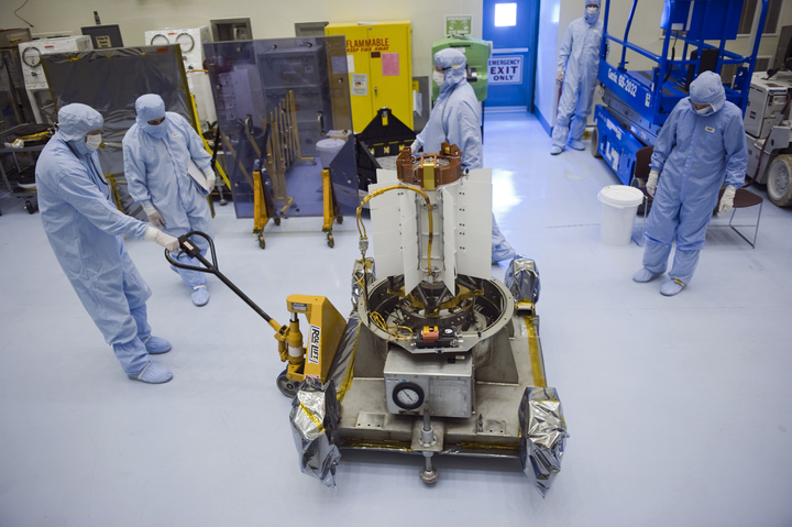 In the Payload Hazardous Servicing Facility at NASA's Kennedy Space Center in Florida, spacecraft technicians from NASA's Jet Propulsion Laboratory park the multi-mission radioisotope thermoelectric generator (MMRTG) for NASA's Mars Science Laboratory (MSL) mission Photo credit: NASA/Kim Shiflett