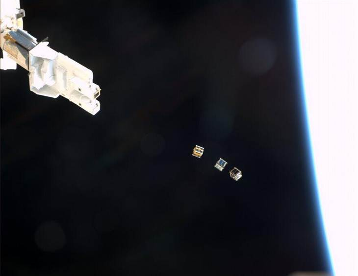 "A picture taken from the International Space Station shows a Japanese-built launcher sending three nanosatellites - ArduSat 1, ArduSat X and PicoDragon - into Earth orbit. Japanese astronaut Koichi Wakata conducted the remote-controlled release. ""Pretty exciting to see live,"" NASA astronaut Mike Hopkins (@AstroIllini) wrote in a Twitter update."