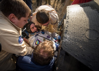 Expedition 36 Flight Engineer Chris Cassidy of NASA is helped out of the Soyuz TMA-08M capsule after he and, Commander Pavel Vinogradov of Russian Federal Space Agency (Roscosmos), and Flight Engineer Alexander Misurkin of Roscosmos landed in a Soyuz TMA-08M spacecraft in a remote area near the town of Zhezkazgan, Kazakhstan, on Wednesday, Sept. 11, 2013. Vinogradov, Misurkin and Cassidy returned to Earth after five and a half months on the International Space Station. Photo Credit: (NASA/Bill Ingalls)
