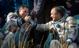 Expedition 36 Flight Engineer Chris Cassidy, left, and Commander Pavel Vinogradov of Russian Federal Space Agency (Roscosmos) shake hands after they, and Flight Engineer Alexander Misurkin of Roscosmos landed their Soyuz TMA-08M spacecraft in a remote area near the town of Zhezkazgan, Kazakhstan, on Wednesday, Sept. 11, 2013. Vinogradov, Misurkin and Cassidy returned to Earth after five and a half months on the International Space Station. Photo Credit: (NASA/Bill Ingalls)