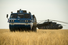 A Russian search and rescue all-terrain vehicle (ATV) and helicopter are seen at the landing site of the Soyuz TMA-08M spacecraft in a remote area near the town of Zhezkazgan, Kazakhstan, on Wednesday, Sept. 11, 2013. The Soyuz landed with Expedition 36 Commander Pavel Vinogradov of the Russian Federal Space Agency (Roscosmos), Flight Engineer Alexander Misurkin of Roscosmos and Flight Engineer Chris Cassidy. Vinogradov, Misurkin and Cassidy are returning to Earth after five and a half months on the International Space Station. Photo Credit: (NASA/Bill Ingalls)