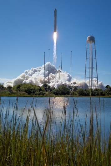 The Orbital Sciences Corporation Antares rocket, with the Cygnus cargo spacecraft aboard, is seen as it launches from Pad-0A of the Mid-Atlantic Regional Spaceport (MARS), Wednesday, Sept. 18, 2013, NASA Wallops Flight Facility, Virginia. Cygnus is on its way to rendezvous with the space station. The spacecraft will deliver about 1,300 pounds (589 kilograms) of cargo, including food and clothing, to the Expedition 37 crew. Photo Credit: (NASA/Bill Ingalls)