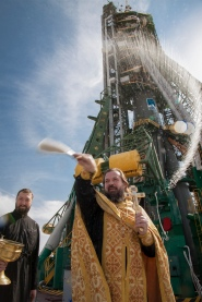 An Orthodox priest blesses members of the public at the the Baikonur Cosmodrome Soyuz launch pad on Tuesday, Sept. 24, 2013 in Baikonur, Kazakhstan. Launch of the Soyuz rocket is scheduled for September 26 and will send Expedition 37/38 Flight Engineer Michael Hopkins of NASA, Soyuz Commander Oleg Kotov and Flight Engineer and Russian Flight Engineer Sergei Ryazansky on a five-month mission aboard the International Space Station. Photo Credit: (NASA/Victor Zelentsov)