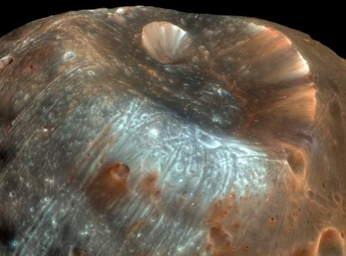 The Martian moon Phobos has accumulated dust and debris from the surface of Mars, knocked into its orbital path by projectiles colliding with the planet. A sample-return mission to Phobos would thus return material both from Phobos and from Mars. Credit: NASA