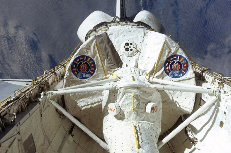 The European Space Agency's (ESA) Spacelab module is seen in the payload bay of space shuttle Columbia during the lab's first spaceflight on the STS-9 mission in 1983.  Credit: NASA/RetroSpaceImages.com