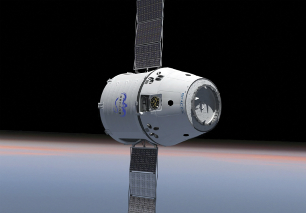 This is an artist concept of SpaceX's Dragon capsule in orbit. (Image Credit: SpaceX)