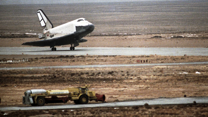 Image via Rt.com The Buran orbiter landing at the Baikonur space center.(RIA Novosti / Alexander Mokletsov)